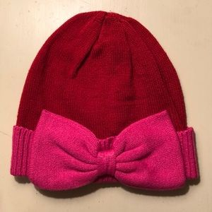 Red and pink Loft beanie with bow